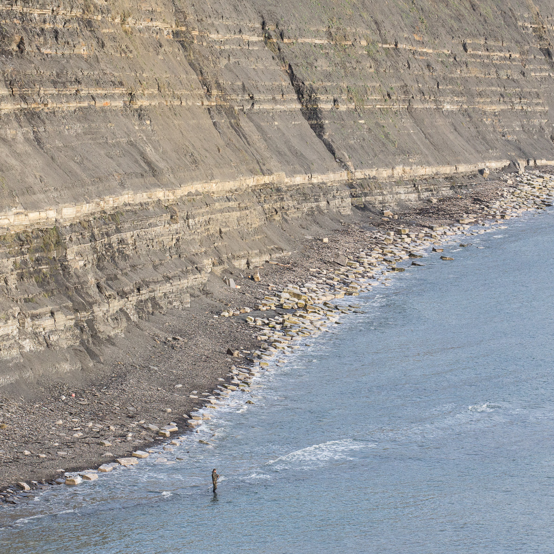 Fisherman at Rope Lake Head cliffs, Dorset