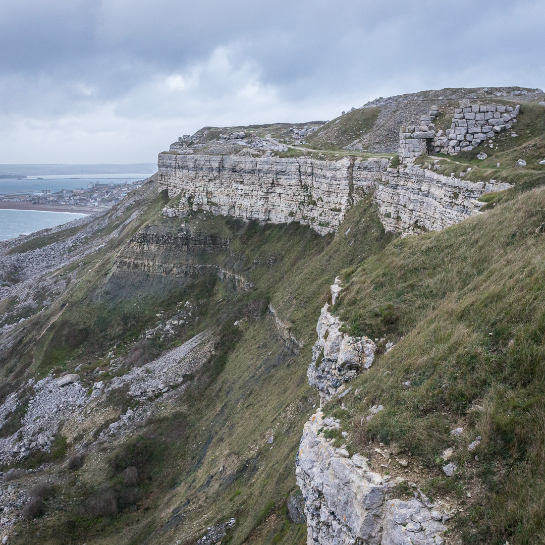 Western cliff-tops and stone tipping bridge near Bowers Quarry, Portland, Dorset.