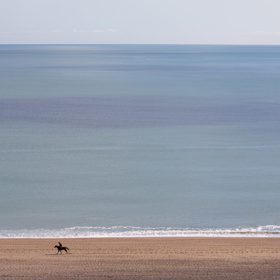 Horse rider on Slapton Sands, Devon.