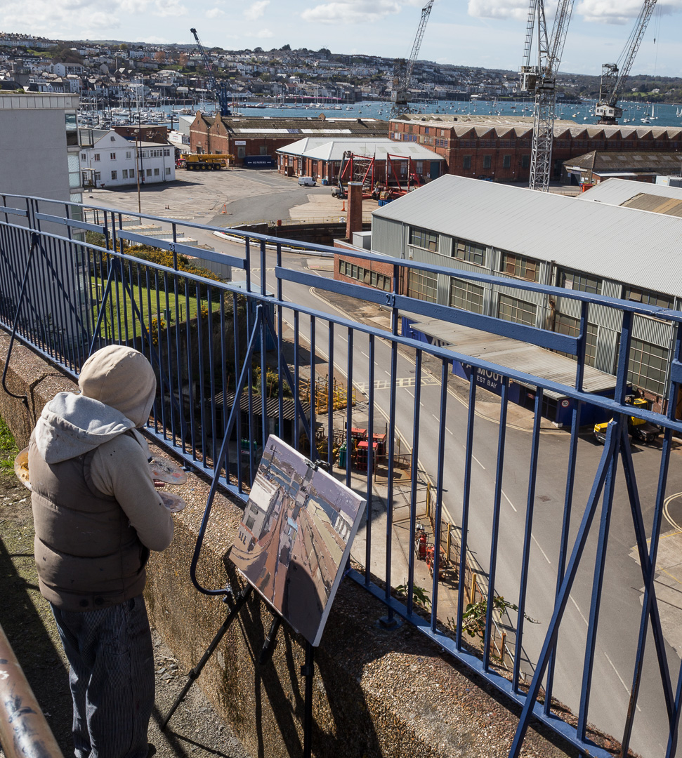Artist Ben Taffinder painting at Falmouth Docks, Cornwall.