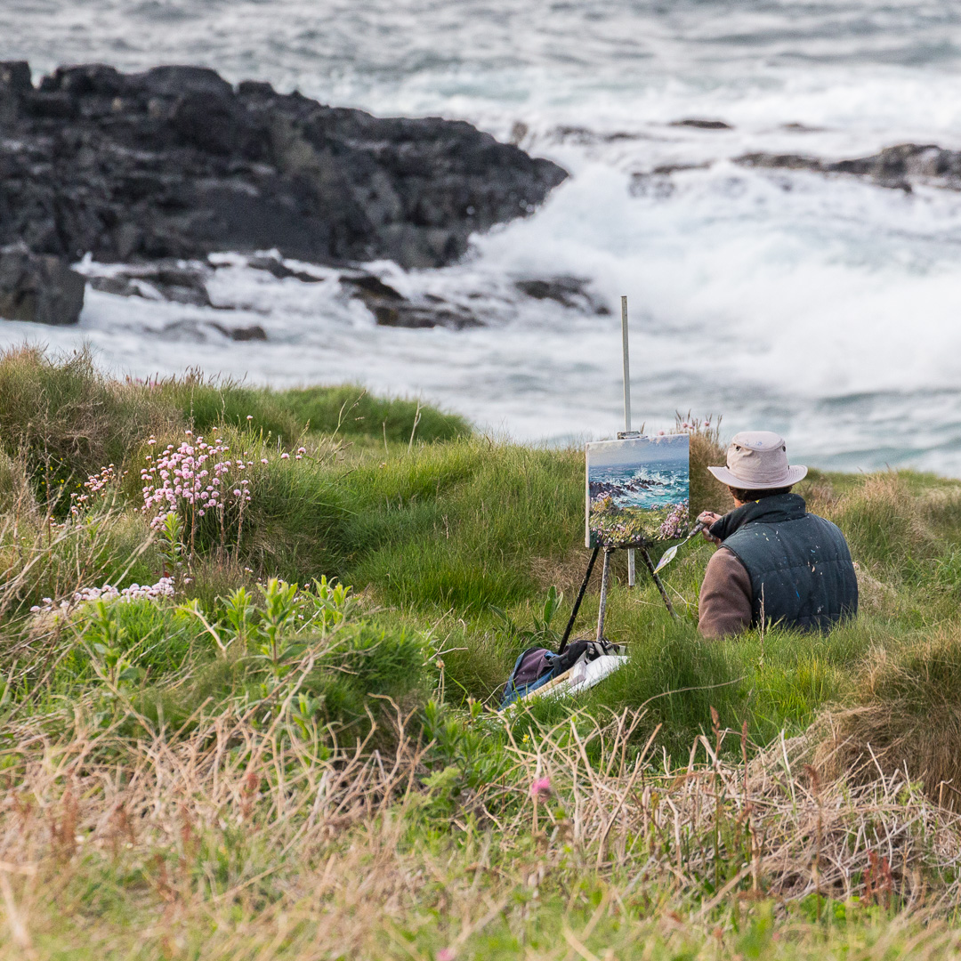 Painter at Clodgy Point, St Ives, Cornwall.