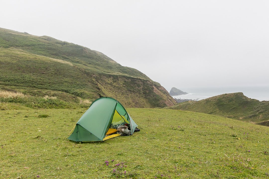 Camp at Marsland Mouth, by the Cornwall - Devon border.