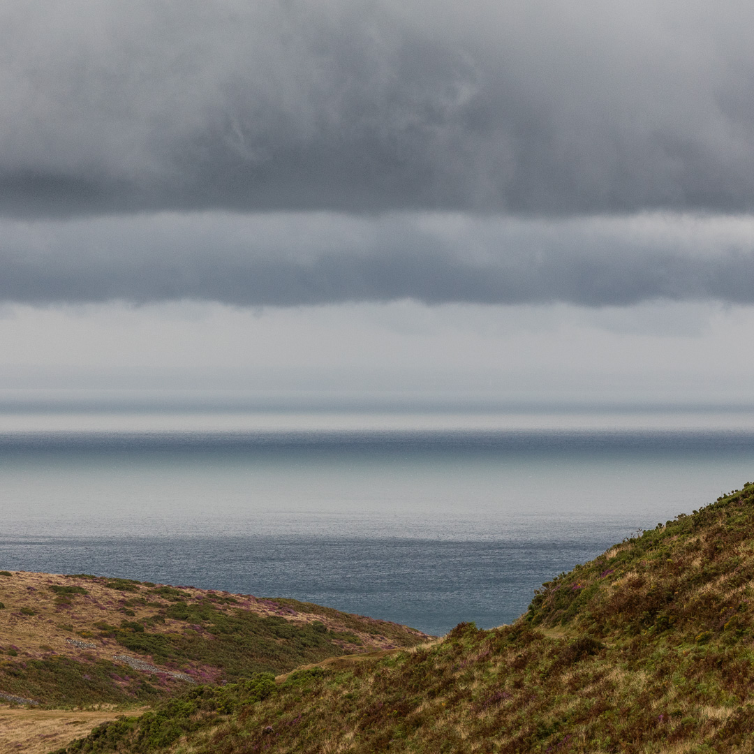 Cloud layers above The Foreland, Exmoor, Devon.