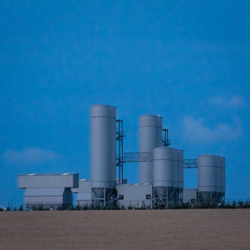 Hinkley Point C nuclear power station, construction site cement silos, Somerset.
