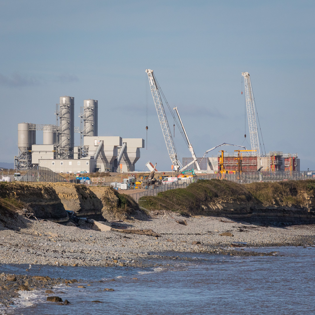 Hinkley Point C nuclear power station, construction site and cement silos, Somerset.