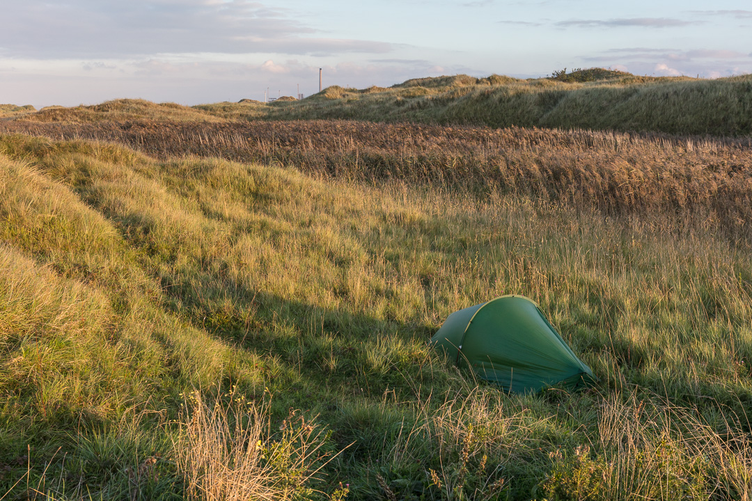 Camp, Kenfig Burows by Tata Steelworks, Glamorgan.