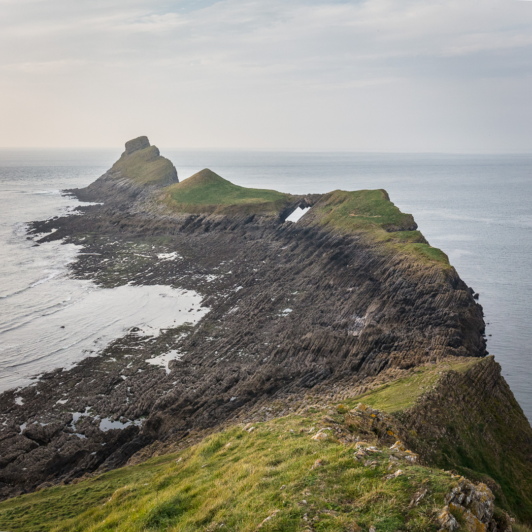 Worm's head. Outer Head, Devil's bridge and low neck from Inner Head. Gower, Glamorgan.