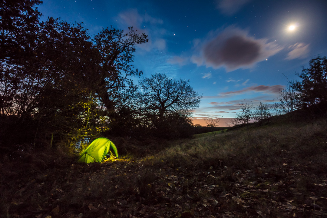 Moonlit camp by the River Taf, near Laugharne, Gwent.