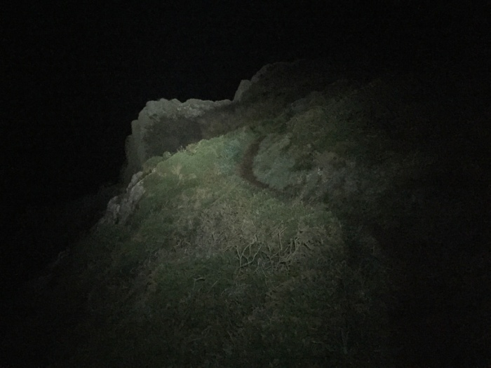 Night hiking above the cliffs of Black Cave, Pembrokeshire.