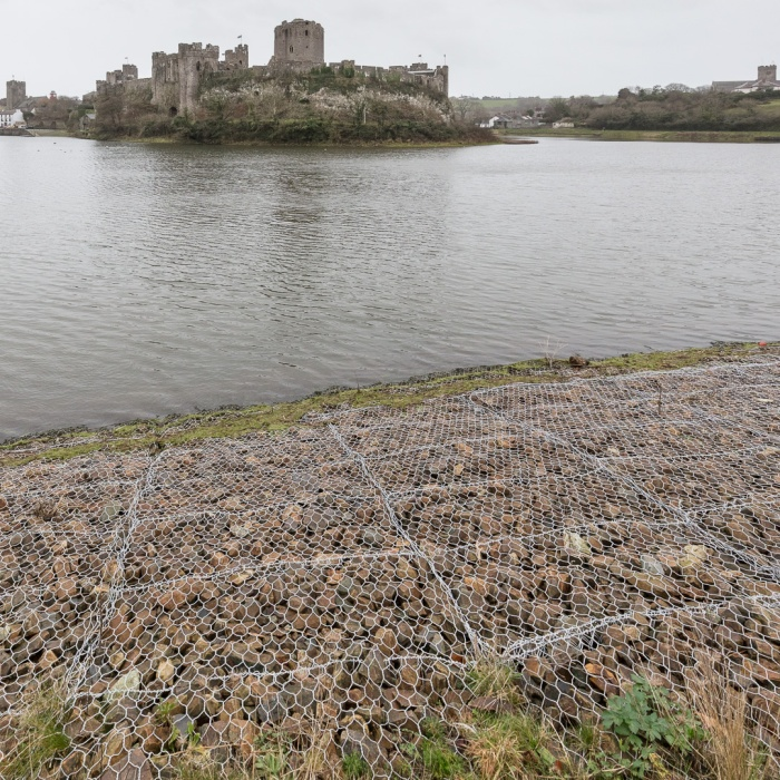 Defences. Contemporary gabion revetments & Pembroke Castle built in 1093, Pembrokeshire.