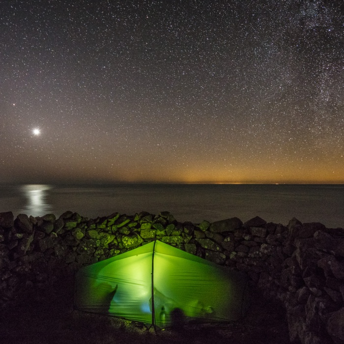 Venus above camp at Penbwchdy, Pembrokeshire. Glow from Ireland across the sea.