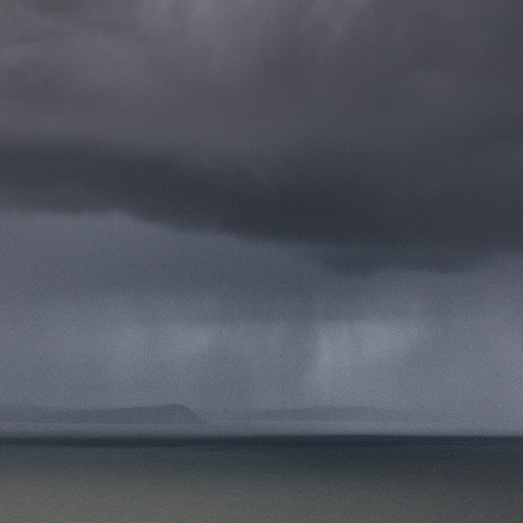 Hail over Dinas Head, Pembrokeshire.
