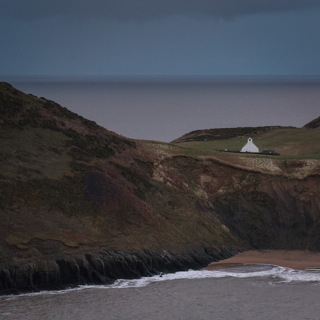 Church of the Holy Cross at dusk, a medieval sailor's chapel of ease, Mwnt, Ceredigion.