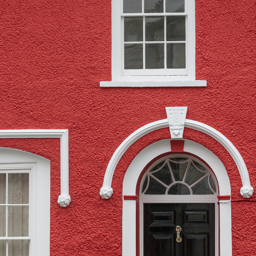 Red facade. Aberaeron was centrally planned in the Regency style by architect Edward Haycock.